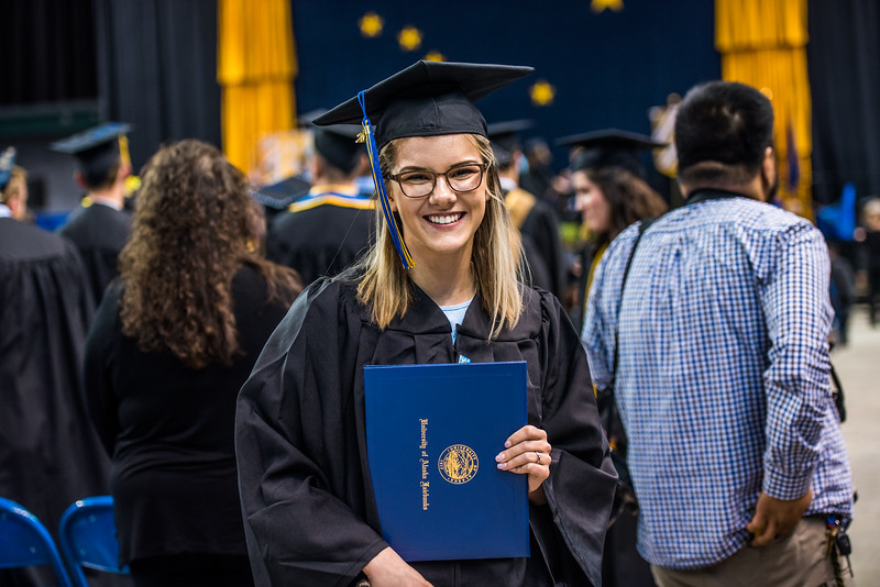 Economics graduate and former Nanook swimmer Noelle Graham poses for a picture during Commencement 2017.
