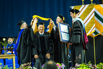 Torre Jorgenson receives an honorary doctor of science degree at the commencement ceremony May 6, 2017, at the Carlson Center.