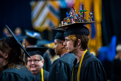 UAF film graduate Ryan Osborne walks back to his seat after receiving his diploma during Commencement 2017.