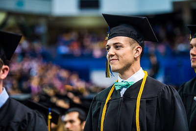 Mechanical engineer and former member of the rifle team Tim Sherry waits in line to receive his diploma during Commencement 2017.