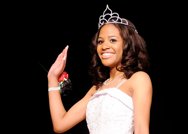 Don Knight | The Herald Bulletin<br /> Natya Vertner waves to the crowd as she is introduced during the Debutante Cotillion Beautillion Militaire at the Paramount on Saturday.