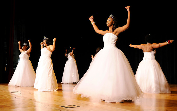 Don Knight | The Herald Bulletin<br /> The Debs perform their dance routine during the Debutante Cotillion Beautillion Militaire at the Paramount on Saturday.