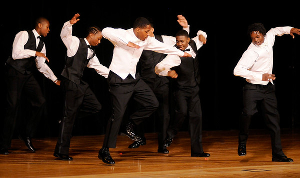 Don Knight | The Herald Bulletin<br /> The Beaus perform their dance routine during the Debutante Cotillion Beautillion Militaire at the Paramount on Saturday.