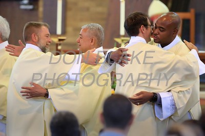 Deacons David Feaster, Jose Sanchez, Lawrence Brecht, and Sean Sudler give each other the Kiss of Peace during the Ordination of eight Deacons at The Church of the Holy Child, Saturday, August 19, 2017. wwwDonBlakePhotography.com