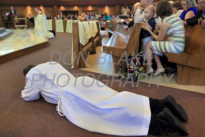 Deacon John Molitor prostrates him self as Bishop Malooly and all in attendance pray during the Ordination of eight Deacons at The Church of the Holy Child, Saturday, August 19, 2017. wwwDonBlakePhotography.com