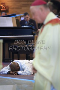 Deacon Sean Sudler prostrates him self as Bishop Malooly prays with all in attendance during the Ordination of eight Deacons at The Church of the Holy Child, Saturday, August 19, 2017. wwwDonBlakePhotography.com