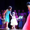 From left 'Little Sisters', Neveah Grimes, 9, helps her sister Neela, 3 with a case of stage fright while bringing a rose to contestant Rianna Lyden of New Castle High School.
