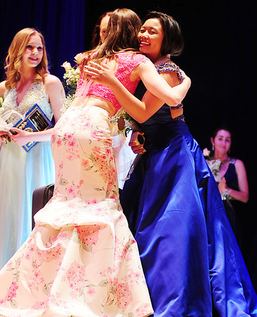 From left, 2016 winner Megan Carnuche embraces 2017 winner Maxine Malvar.