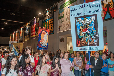 St. Michael Church in Gainesville brings a group by bus each year to the Eucharistic Congress. This year, the group was comprised of half adults and half middle school students. They participated in the morning procession. Beth Andert has served as the coordinator of the parish trip for four years. Photo by Thomas Spink