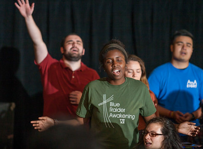 from left to right Andrew Knuckles 22, Nneoma Igwedibie 18both from the Catholic Center at Kennesaw State University and Steven Vu 21 from Holy Martyrs VietnameseCatholic Church sing Praise and Worship During Friday Nights Revive Track.  The Eucharistic Congress brought  together Catholics from across the archdiocese and the country to celebrate the visible, living presence of Jesus in the Eucharist on Friday June 16 and Saturday June 17, 2017 at the Georgia International Convention Center in College Park.  Approximately 30,000 Catholics attended this annual spiritual and multicultural celebration.   This conference featured workshops presented on tracks in five languages:  English, Spanish, American Sign Language, Vietnamese, and French. Some of this year's speakers include Brandon Vogt, Deacon Harold Burke-Sivers, Dr. Gianna Molla, Father Larry Richards, Fr. Michael E. Gaitley, MIC and Sister Jane Dominic Laurel, O.P. (Photo by Thomas Spink)