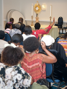 French-speaking Catholics pray in adoration during the Friday evening Francophone track at the Eucharistic Congress. More than 50 people attended the session to hear the speaker, Father Leon N'Zi, a native of Ivory Coast, West Africa. Photo by Thomas Spink