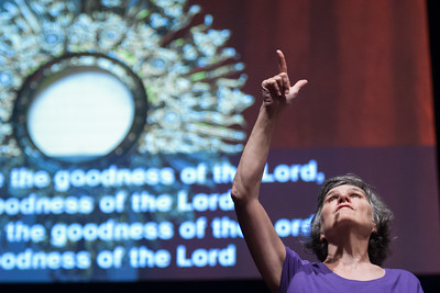 Kathy Byane from Saint Olivers speaks ASL during Saturday Mornings Eucharistic Congress. The Eucharistic Congress brought  together Catholics from across the archdiocese and the country to celebrate the visible, living presence of Jesus in the Eucharist on Friday June 16 and Saturday June 17, 2017 at the Georgia International Convention Center in College Park.  Approximately 30,000 Catholics attended this annual spiritual and multicultural celebration.   This conference featured workshops presented on tracks in five languages:  English, Spanish, American Sign Language, Vietnamese, and French. Some of this year's speakers include Brandon Vogt, Deacon Harold Burke-Sivers, Dr. Gianna Molla, Father Larry Richards, Fr. Michael E. Gaitley, MIC and Sister Jane Dominic Laurel, O.P. (Photo by Thomas Spink)