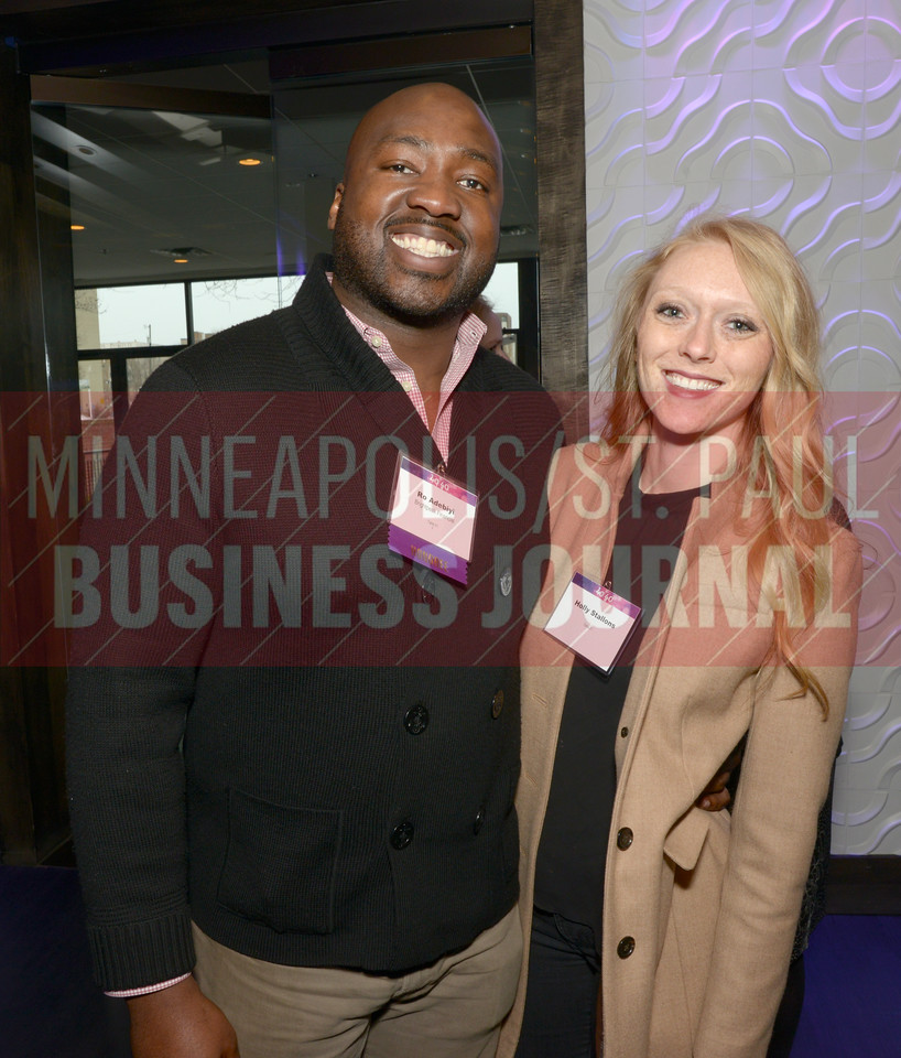 2017 40 Under 40 honoree Ro Adebiyi of Brightpeak Financial with Holly Stallons