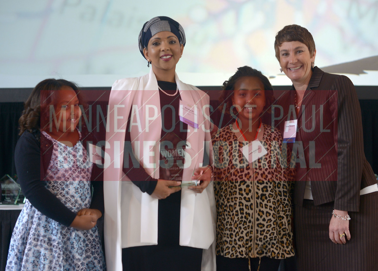 Khadija Ali of Global Language Connections accepted her 2017 Women in Business award with her two daughters.