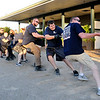 "Don Knight | The Herald Bulletin<br /> Police win the Tug-O-War during the ""Guns & Hoses"" event at Hoosier Park on Saturday. The event is a fundraiser for the Madison County Fire Rescue House."