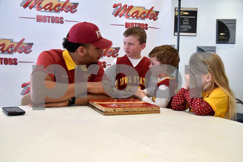 -Messenger photo by Britt Kudla<br /> Iowa State Nazareth Mitrou-Long chat with Colton (7) Tyler (4) and Tinsley (4) Bowen of Winterset during a meet-N-greet at Macke Motors on Friday