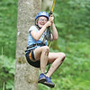 Star Photo/Bryce Phillips <br />  A young ranger flies down a zipline as she completes the Junior Rangers Challenge course.
