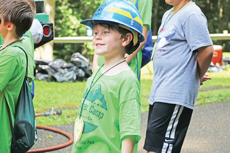 Star Photo/Bryce Phillips <br /> A curious ranger tries on a helmet that is used by the United State Forestry Service.