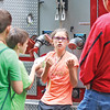 Star Photo/Bryce Phillips <br /> A junior ranger is full of questions as she learns about fighting fire from a member of the Roan Mountain Volunteer Fire Department.