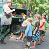 Star Photo/Bryce Phillips <br /> A member of the United States Forestry Service teaches a group of junior rangers about how the Service fights forest fires.