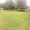 Pano grassy field from the front and side of house