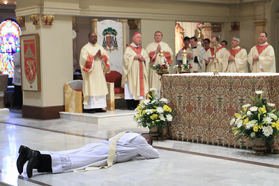 Richard Jasper prostrates him self on the alter during his Ordination at Cathedral of Saint Peter Church, Saturday, May 20, 2017. wwwDonBlakePhotography.com