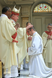 Bishop Malooly lays hands on Richard Jasper during his Ordination at Cathedral of Saint Peter Church, Saturday, May 20, 2017. wwwDonBlakePhotography.com