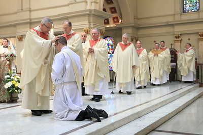 Priests lay hands on Richard Jasper during his Ordination at Cathedral of Saint Peter Church, Saturday, May 20, 2017. wwwDonBlakePhotography.com