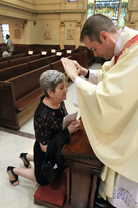 Fr. Richard Jasper blesses his mother after his Ordination at Cathedral of Saint Peter Church, Saturday, May 20, 2017. wwwDonBlakePhotography.com