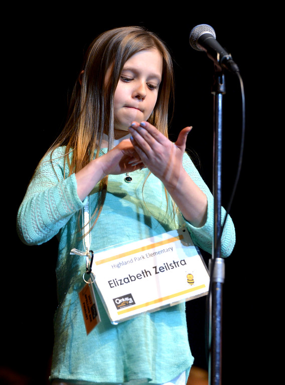 Justin Sheely | The Sheridan Press<br /> Highland Park Elementary student Elizabeth Zeilstra writes out a word with her finger during the 2017 Sheridan County Spelling Bee hosted by Century 21 BHJ Realty Saturday at the WYO Theater.