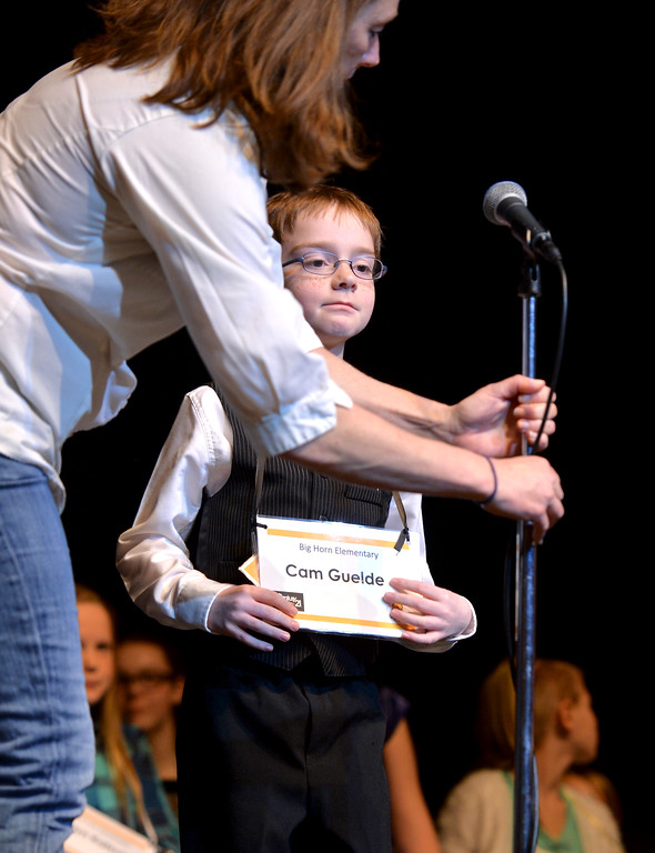 Justin Sheely | The Sheridan Press<br /> Big Horn Elementary student Cam Guelde steps up to the microphone during the 2017 Sheridan County Spelling Bee hosted by Century 21 BHJ Realty Saturday at the WYO Theater.