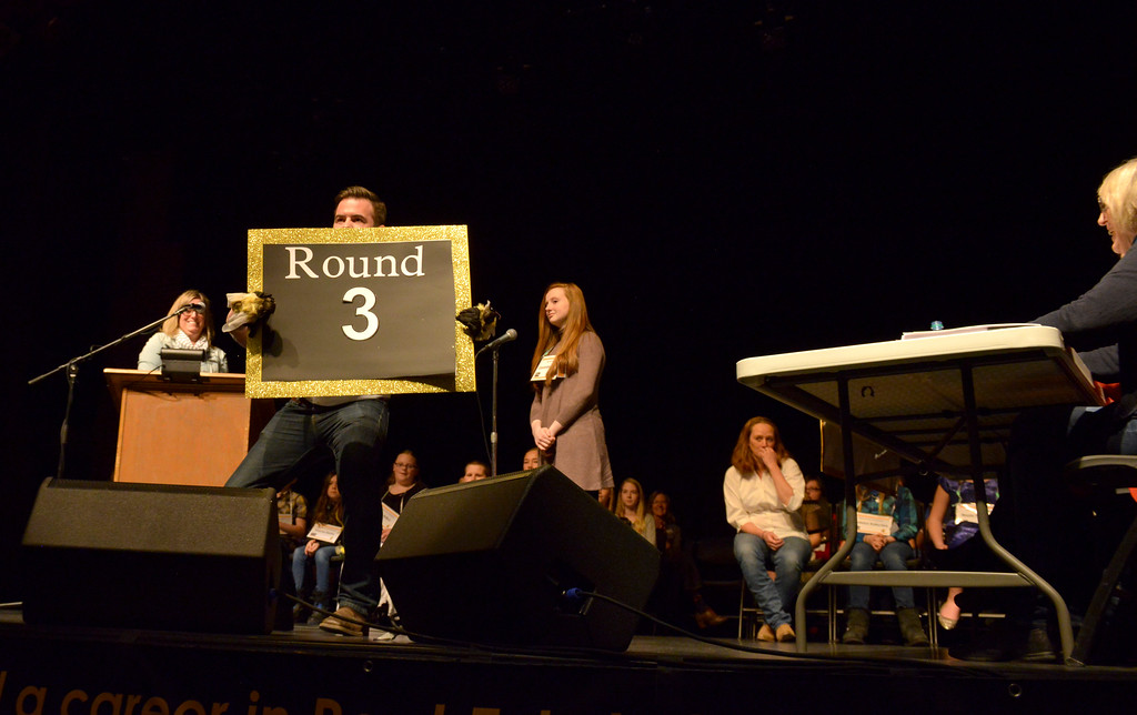 Justin Sheely | The Sheridan Press<br /> BHJ associate Joe Steger announces the next round during the 2017 Sheridan County Spelling Bee hosted by Century 21 BHJ Realty Saturday at the WYO Theater.