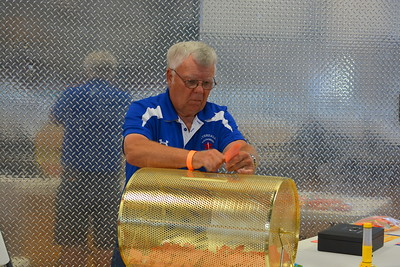 Jerry Ranum separating raffle tickets @ Riverdale, ND Ambulance Squad annual fundraiser at Riverdale High Lodge - 7-15-17