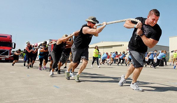 John P. Cleary |  The Herald Bulletin<br /> The Guns and Buns co-ed team pulled their way to a first place finish in their division in Saturday's United Way's 4th annual Human Truck Pull.