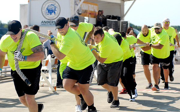 John P. Cleary |  The Herald Bulletin<br /> Members of the Madison County Finest men's team defended their title by winning the men's division again this year in United Way's 4th annual Human Truck Pull.