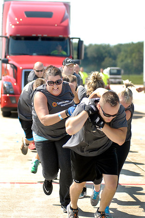 John P. Cleary |  The Herald Bulletin<br /> Members of the Community Strong co-ed team pulls their way into the finals of <br /> United Way's 4th annual Human Truck Pull Saturday. The Community Strong team finish 2nd in the co-ed division.