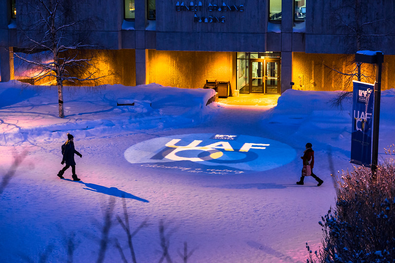 A projection of UAF's 100 year anniversary logo is seen next to the Gruening Building Friday, January 20, 2017.