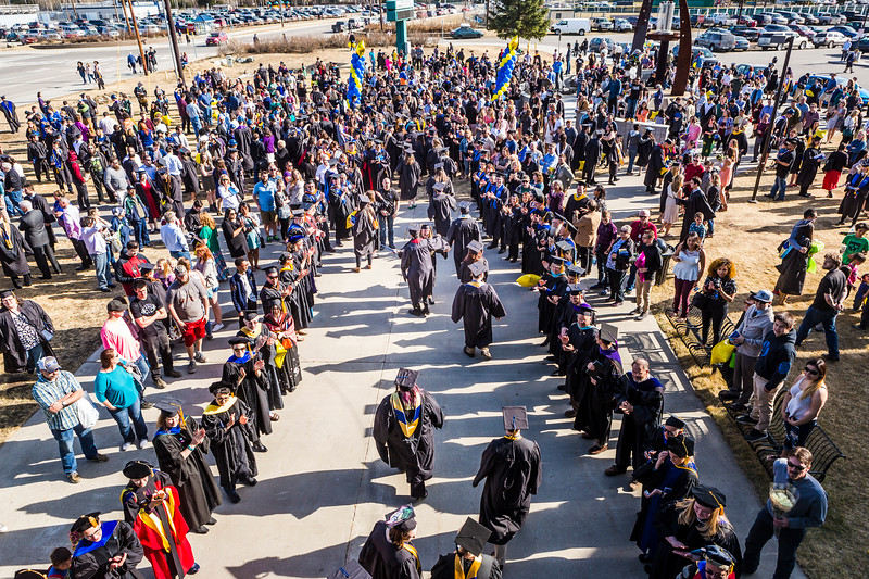 Forming two lines outside the Carlson Center, faculty greet and congratulate graduates after the Commencement 2017 ceremony on May 6 in Fairbanks.