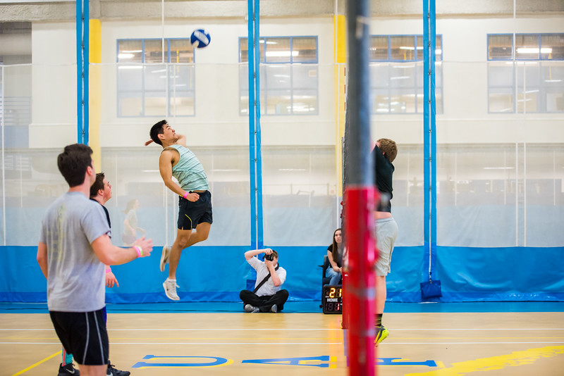 Civil Engineering student Jae Ham jumps during Spring Fest mud vollleyball. Due to the high sno levels outside, mud volleyball was moved inside to the SRC.