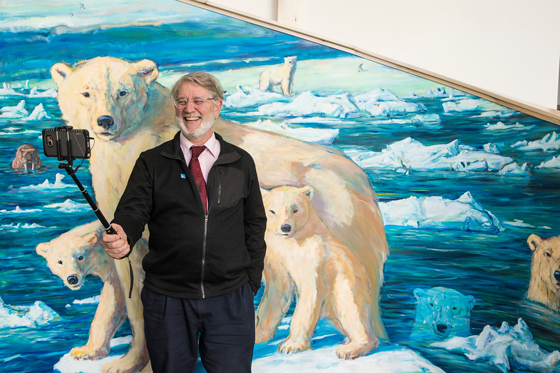 "UAF College of Liberal Arts Dean Todd Sherman takes his own picture in front of the ""selfie station"" in the University of Alaska Museum of the North before signing the artwork on Tuesday, Sept. 26, 2017. Sherman painted the piece while members of the public looked on as part of the museum's ""Polar Passion"" special exhibit."