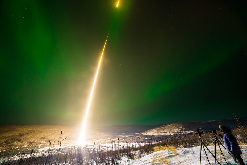 Swiss national Yannic Bartolozzi photographs a rocket taking off into the aurora from Poker Flat Research Range on the night of Feb. 21.
