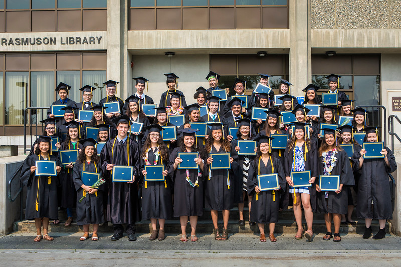 Participants in UAF's 2017 Rural Alaska Honors Institute gather in front of the Rasmuson Library after their graduation ceremony Thursday, July 24, 2017.
