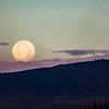 The Harvest Moon, as seen from campus, sets behind Ester Dome on the morning of Friday, October 6, 2017.