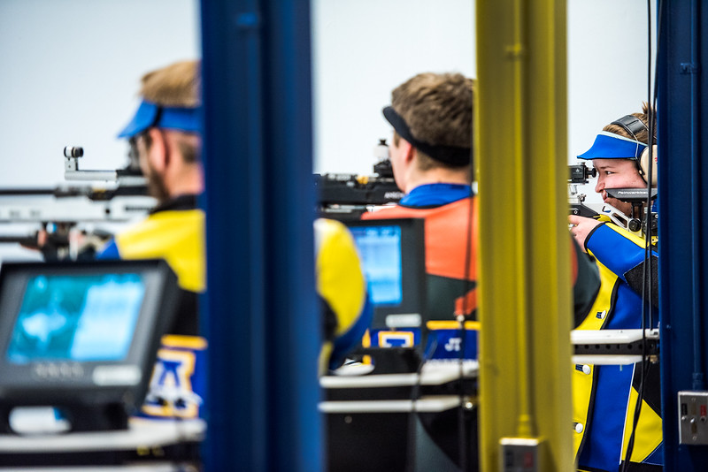 Robert Scott (left), JT Schnering (middle), and Grace Nelson (right) compete during the Nanook rifle team's first home match of the year against Ohio State University on Oct. 14, 2017.