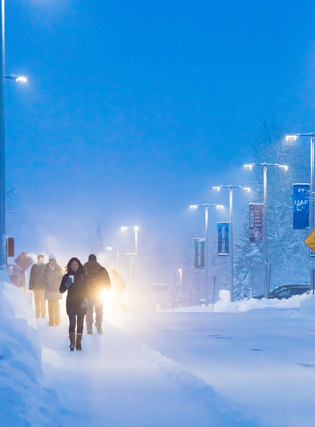 Students walk toward lower campus while Fairbanks temperatures reach forty below.