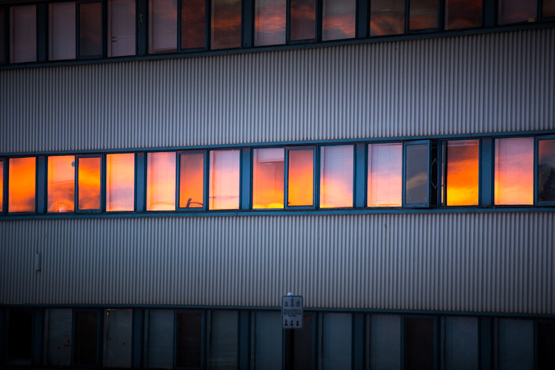 The sunset is reflected in the Wickersham Hall windows on Nov. 29, 2017.