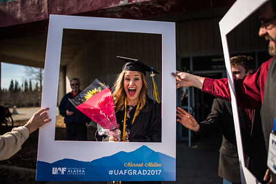 A 2017 UAF graduate poses for portrait following her commencement ceremony at the Carlson Arena.