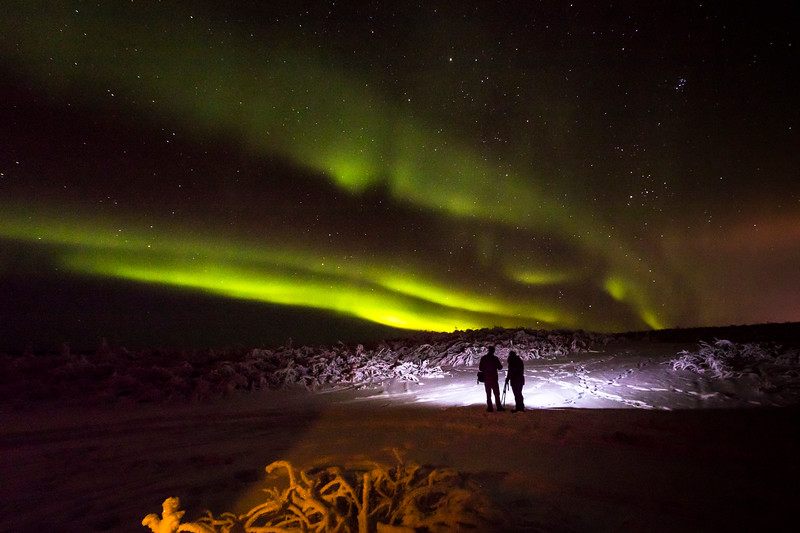 UAF students photograph the aurora during a workshop held by UAF Outdoor Adventures at Murphy Dome.