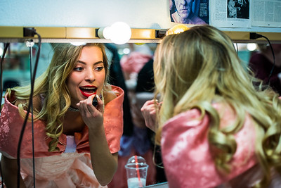Meghan Fowler puts on lipstick prior to the final rehearsal of UAF's Five Women Wearing the Same Dress on Friday, Mar. 30.