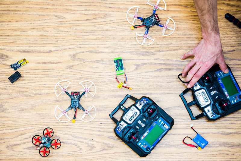 ACUASI employees fly miniature drones during a promotional photoshoot for an upcoming drone racing competition.